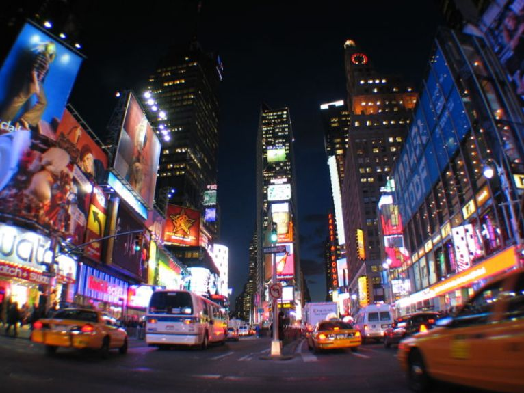 Times Square in Manhattan is named after the Times Building, the former offices of the New York Times. It is sometimes known as the Crossroads of the World. Times Square is principally defined by its animated, digital advertisements.