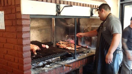 Cooking restaurant meat asado style in Argentina