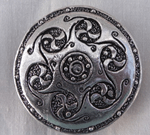 sculpted round brooch
