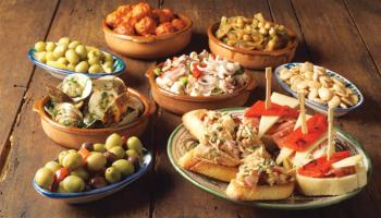 Tapas are bite-sized, savory dishes in Spain that are usually enjoyed with drinks