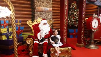 Santa giving out Snickers chocolate bars at City of Dreams' main entrance_