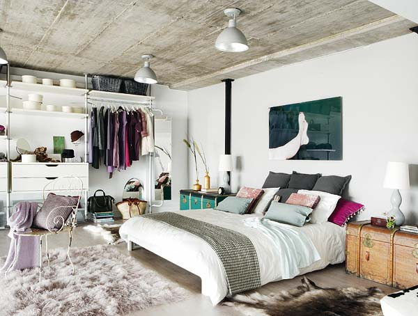 Photo of eclectic bedroom with painting over bed (from trendir.com)