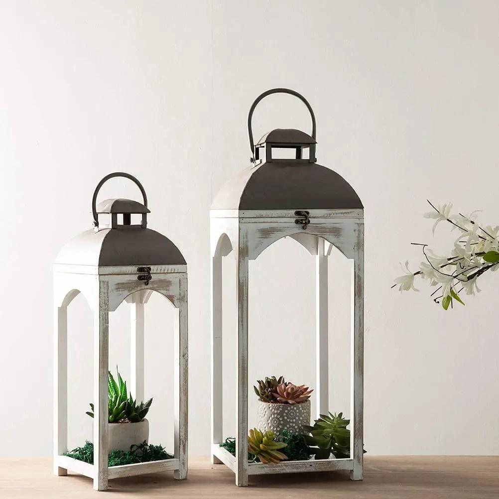 decorative lanterrns holding succulents