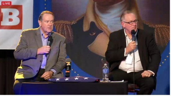 Mike Huckabee onstage with Trevor Loudon via Breitbart [screenshot]