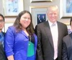 Donald Trump standing next to Gaby Pacheco
