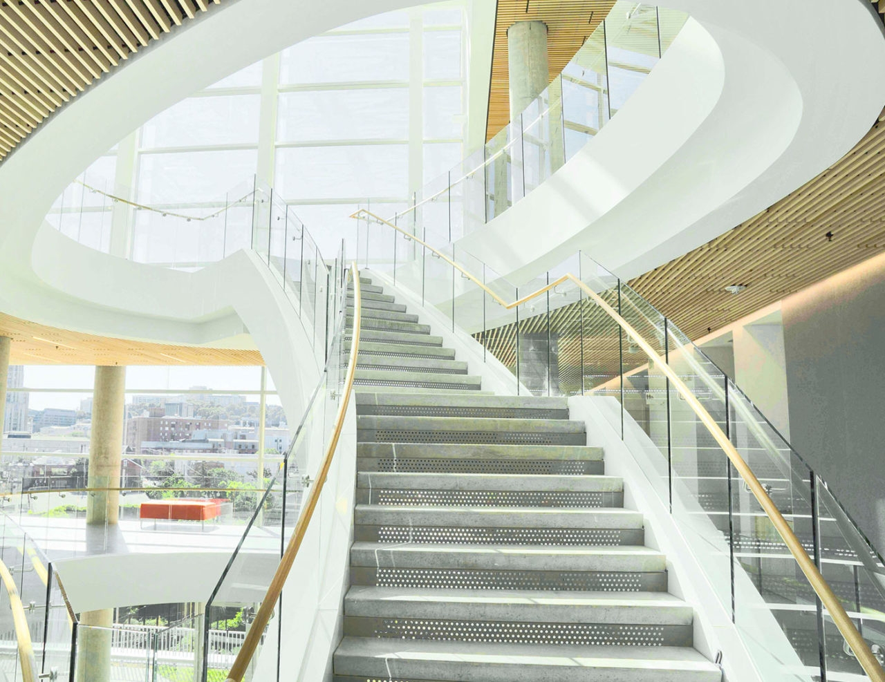 Base Shoe Commercial Glass Railing Trex Commercial Products | Staircase Design For Commercial Buildings | Cylindrical Glass | Enclosed | Beautiful | Central Staircase | Sleek