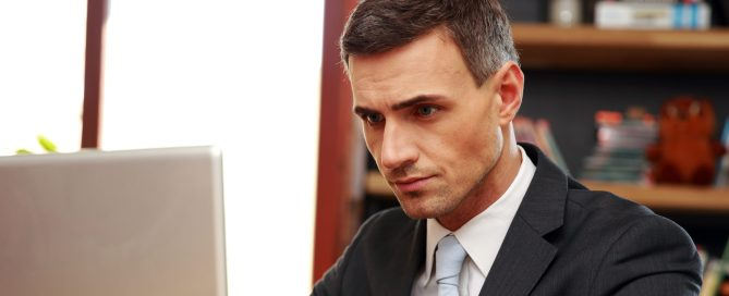 Confident courtroom presentation tech sitting with laptop at office