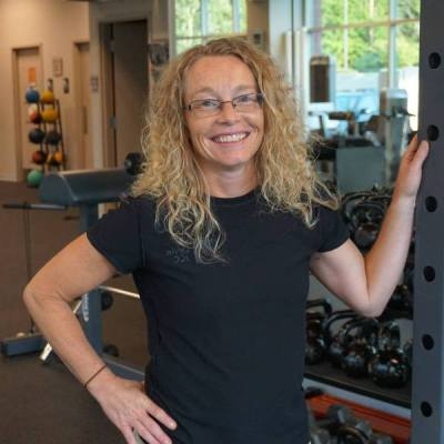 Michelle Hart has been helping people reach their health and wellness goals for over 20 years. Her background in gymnastics and circus performance led her to pursue and obtain Bachelor's and Master's degrees from Illinois State University in Exercise Physiology. She then ascended into several professional roles which brought to her repertoire over a decade of experience coaching and training many of all ages.