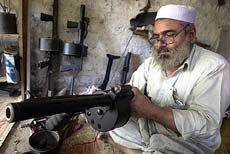 Pakistani tribesman makes a grenade launcher in the Darra Adam Khel tribal area, 47 km from Peshawar
