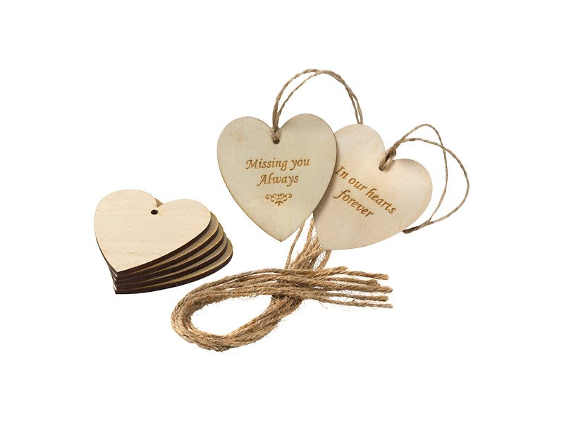 Ply heart tags engraved with various messages.
