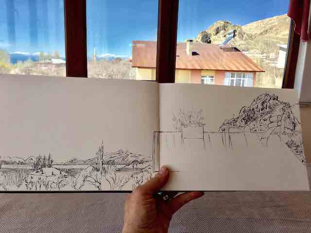 Photo of Trici's sketchbook with Kef Kalesi in the background