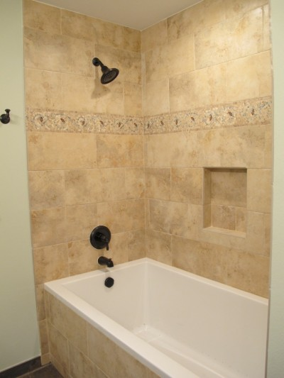 A double bathroom remodeling project worth moving out for ...
