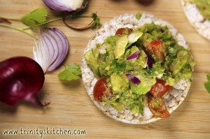 A delicious guacamole dip on a ricecake.
