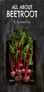 Bunch of raw fresh beetroots on a dark rustic background, plenty of copy space