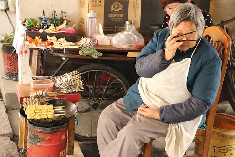 Chinese Grandmother at Foodstall
