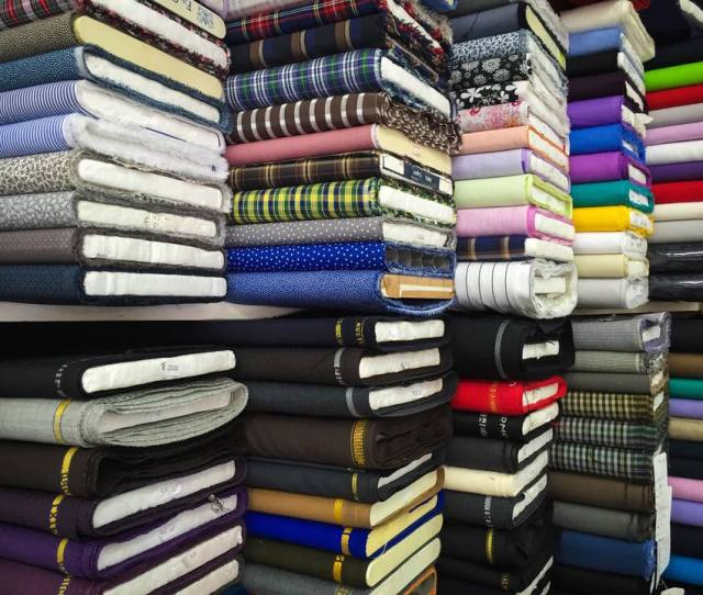 Bolts Of Fabric Stacked In A Store