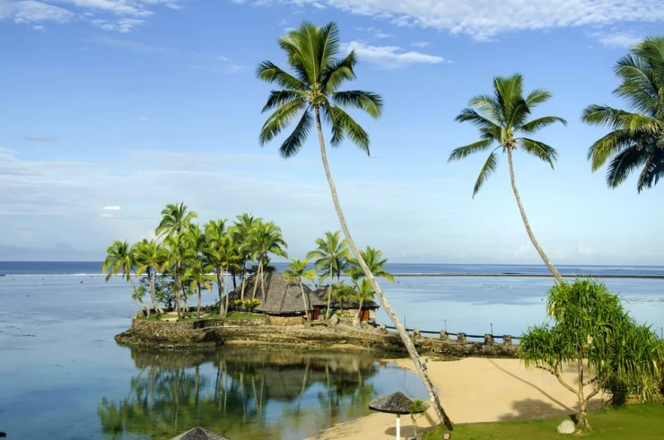 Cluster of thatched roof buildings on Fiji's Coral Coast, Viti Levu Island
