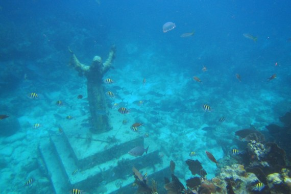 "The ""Christ of the Deep"" statue is located at Key Largo Dry Rocks reef. It is over 8 feet tall and weighs 4,000 pounds! Seeing it was amazing will the fish and jellyfish drifting in the currents above the outstretched arms!"