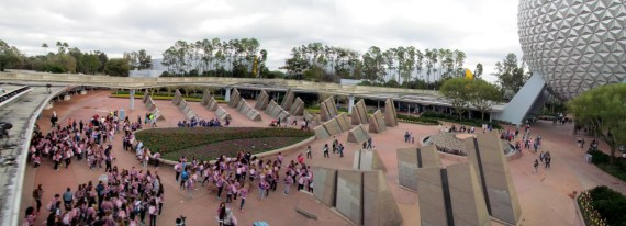 On the People Mover Monorail from Magic Kingdom to Epcot there is such great views of the park and grounds. from a nice high angle. There are lots of groups wearing the same colored t-shirts so they can recognize each other. This is passing by the Spaceship Earth Ball and looking down at the Memorial Stones at the entrance to Epcot.