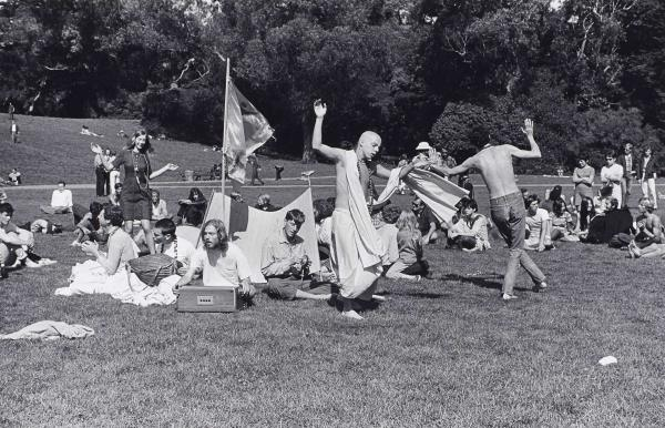"Ruth-Marion Baruch, ""Hare Krishna Dance in Golden Gate Park, Haight Ashbury,"" 1967. Gelatin silver print. Lumière Gallery, Atlanta, and Robert A. Yellowlees. Courtesy Special Collections, University Library, University of California Santa Cruz. Pirkle Jones and Ruth-Marion Baruch Photographs"