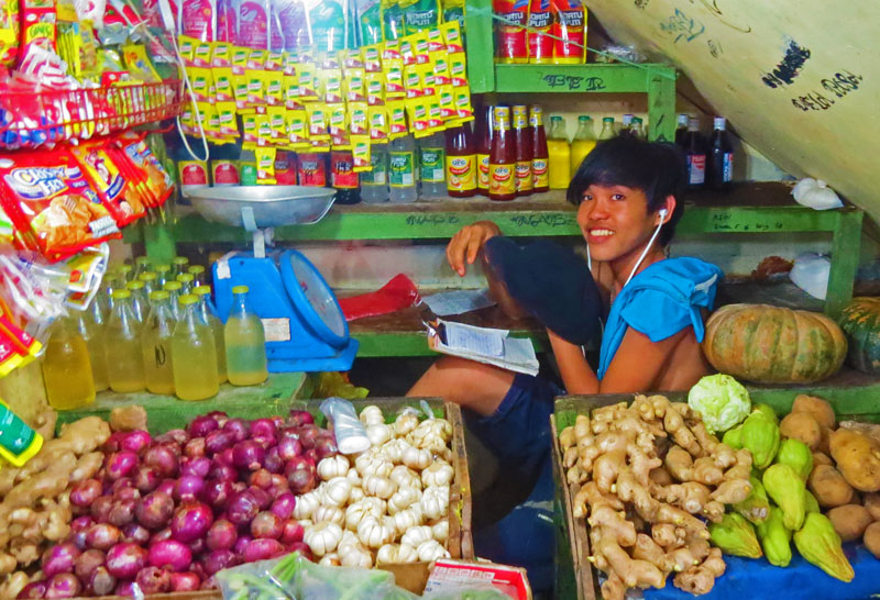 Filipino foods overflow tables in the Puerto Princesa market