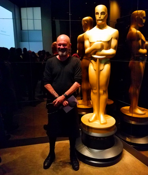 Posing with the Oscar statue before the Academy Awards
