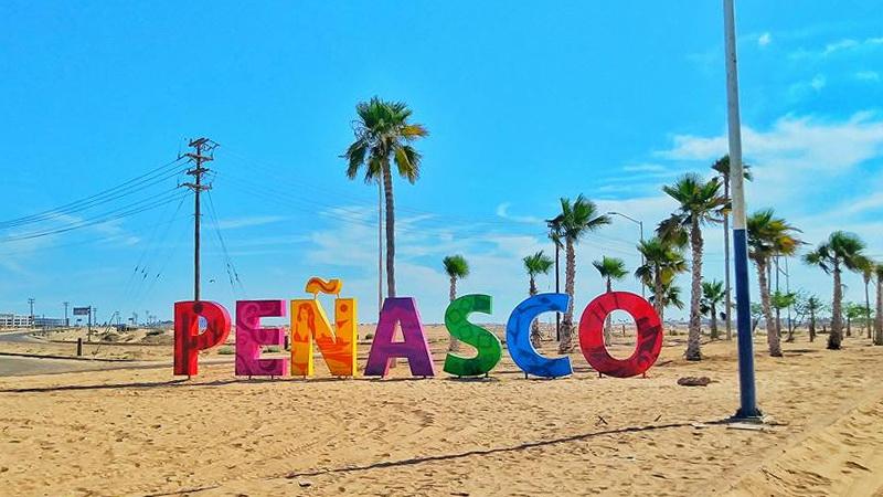 Penasco sign on beach