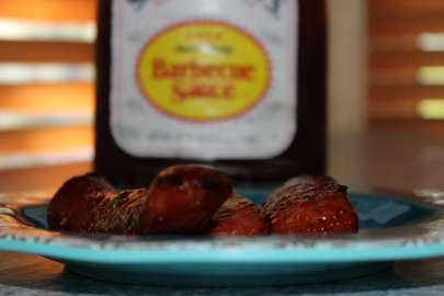 Sweet Baby Ray's makes this messy BBQ sausage extra delicious.