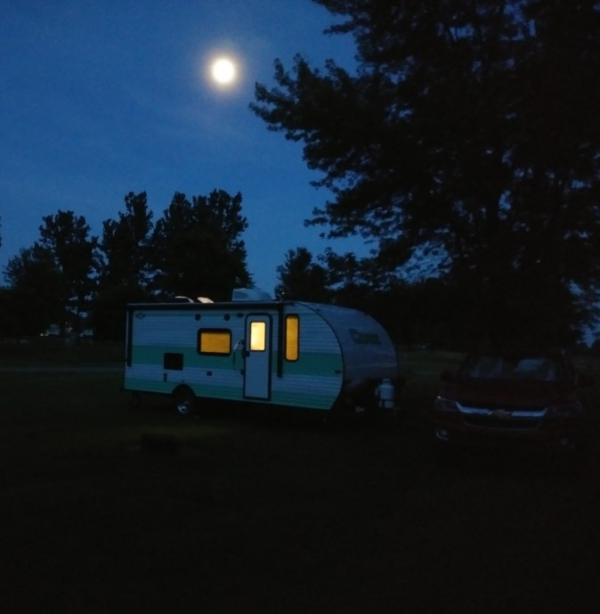 full-time rv living -- trailer and truck at a campground at night