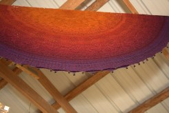 I bought some gradient yarn from Fiber Optik to make a shawl just like this one.