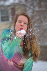 Blowing a snow kiss