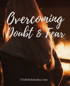 Back of blonde woman with title 'Overcoming Doubt & Fear'
