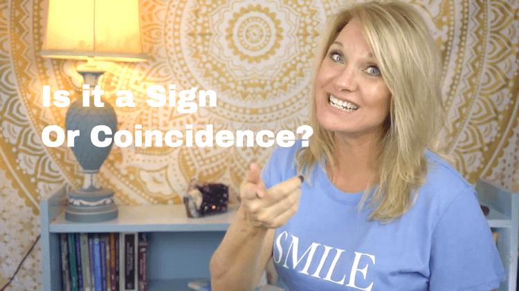 "Trish McKinnley wearing blue t-shirt in a room with the title beside her ""is it a sign or a coincidence?"""