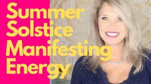 Trish McKinnley smiling with 'Summer Solstice Manifesting Energy' written beside her