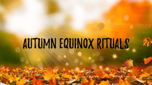 Autumn leaves on ground in bright sunlight with title'autumn equinox rituals' on top