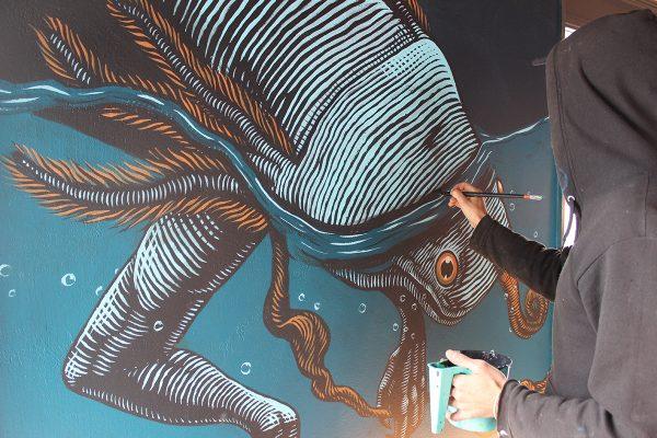 Mazatl painting an Axoltl