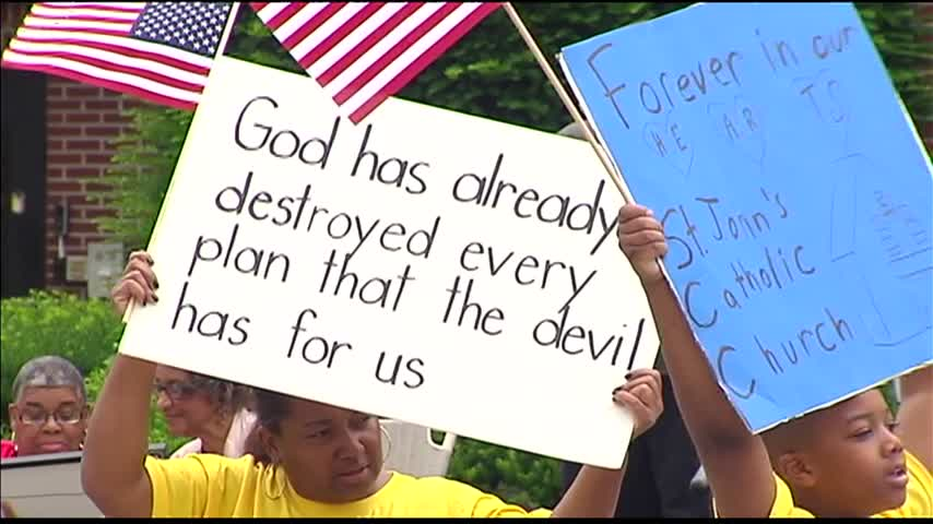 Protesters Unhappy Over Church Merger_96680256