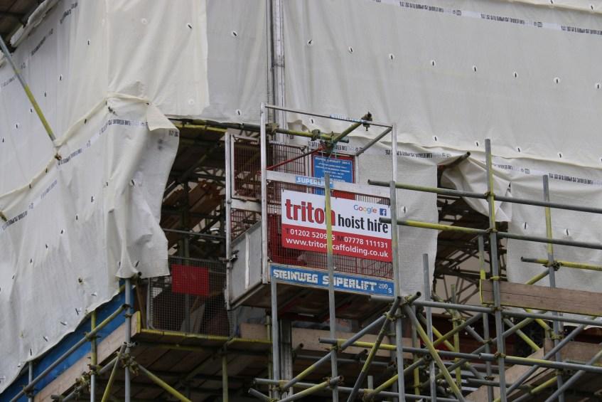 Close up of a Hoist Hire on a Scaffolding Project - Triton Scaffolding Ltd