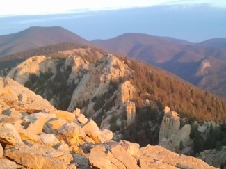 The glow of sunrise on top of the Tooth of Time July 13th.
