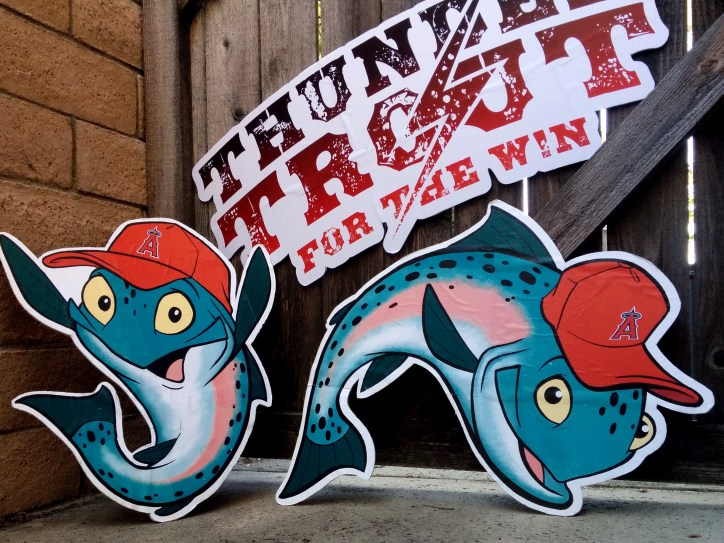 Picture of three Mike Trout Stadium signs