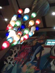 Colorful chandeliers and murals adorn the ceilings of La Griglia.