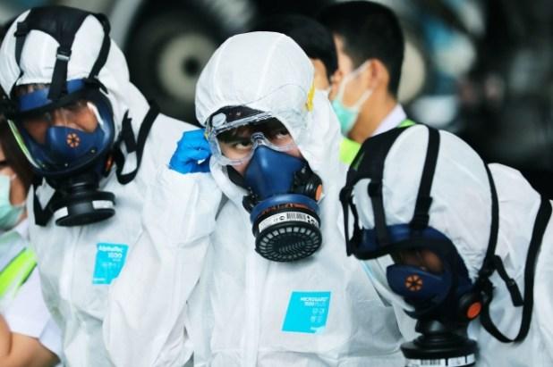 Koronavirüse müdahale eden kişilerin ekipmanları da daha farklı. Foto: Patipat Janthong / Getty Images