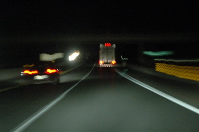 Driving at night can be challenging because of the body's biologically hardwired tendency to sleep when it's dark. Lighter traffic densities, however, mean it's statistically safer. Photo: Jim Park