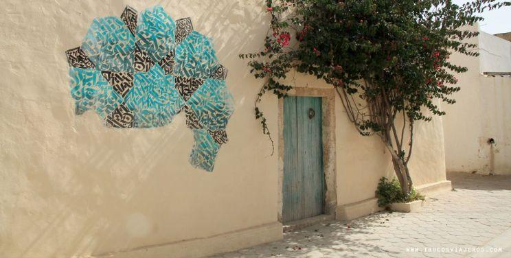 blue and green calligraphic graffiti Tunisia Djerba