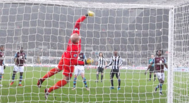 Guzan of villa makes save at the Gallowgate end