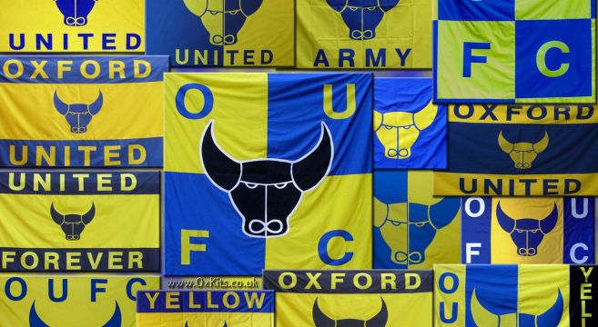 Wall of Oxford United blue and Yellow bulls head flags