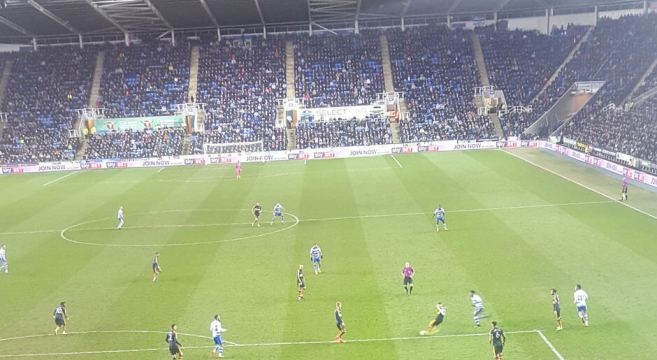 View frommback of the away end at Reading as Newcastle defend a Reading attack, Ritchie clears the ball
