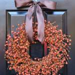 This large artificial orange and pumpkin berry wreath measures 20 inches in diameter and 4 inches deep. This beautiful wreath will add to any Fall celebration. This wreath may be able to fit in between a storm door. Available in sizes 18-24 inches in diameter.