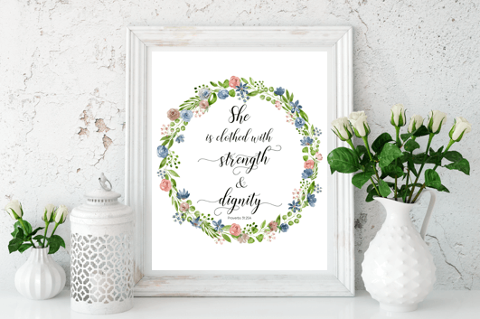 """She is clothed with strength and dignity."" Download this free printable art scripture quote from Proverbs 31.25 with wreath design. More freebies at www.trueblissdesigns.com #wallart #printable #freeprintable #bibleverse #proverbs #bibleart"