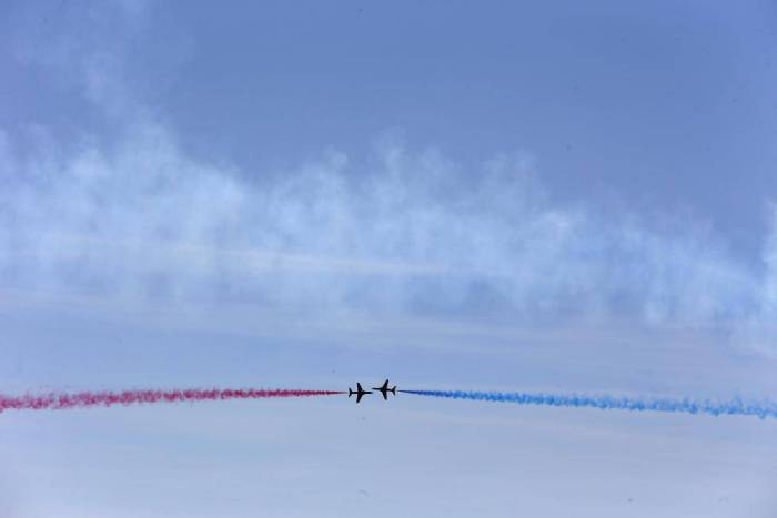 The Royal Air Force aerobatic team, the Red Arrows, perform during a D-Day event in Portsmouth